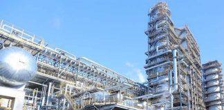 Atyrau oil refinery under a blue sky