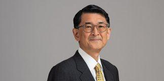 Kazuhiko Koguchi against grey background