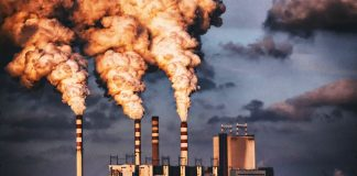 pollution rising from power station chimineys