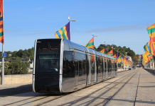 Tram in Tours, flanked by local flags