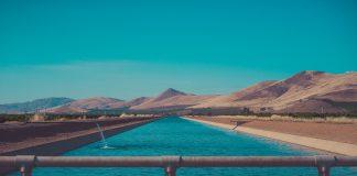 Water in a reservoir set against an arid landscape